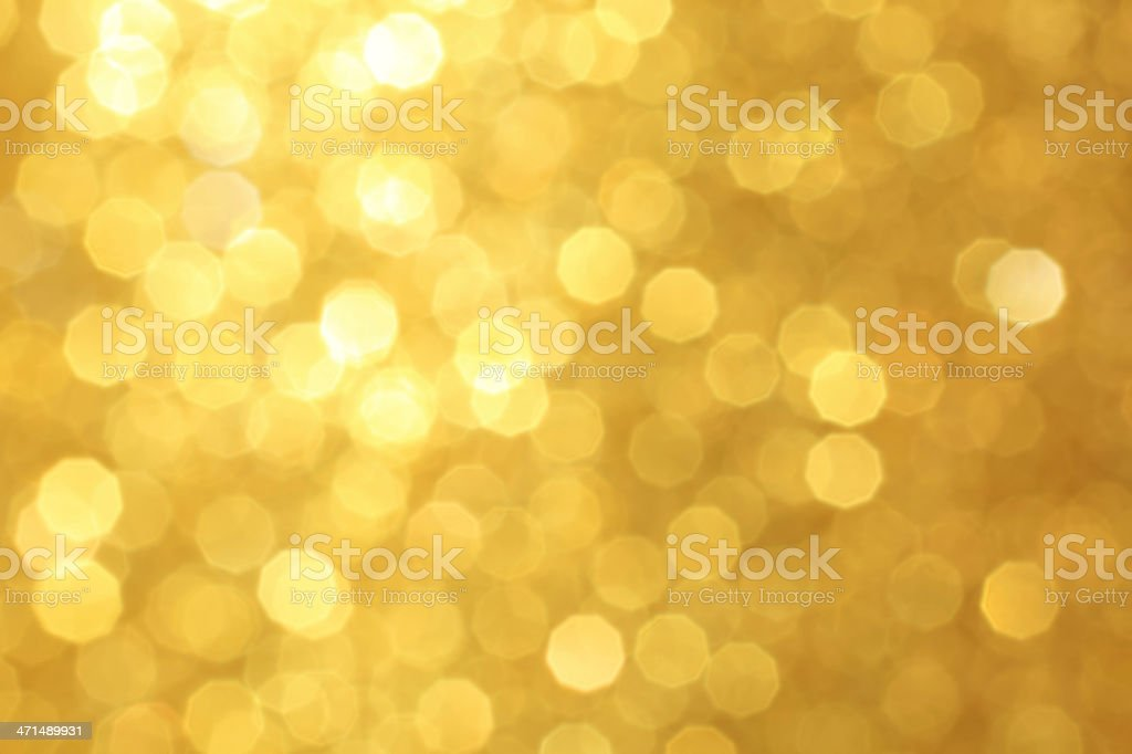 Golden unfocused light background stock photo
