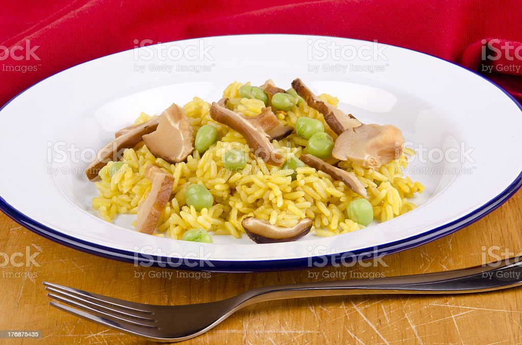 golden vegetable rice with mushrooms and pea royalty-free stock photo