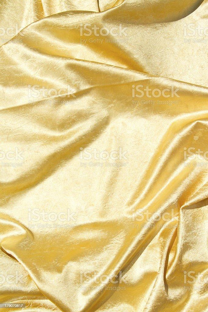 Golden velvet cloth royalty-free stock photo