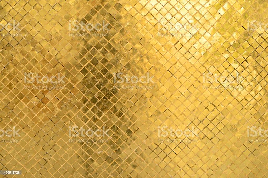 Golden wall of Temple of Emerald Buddha, Bangkok, Thailand royalty-free stock photo