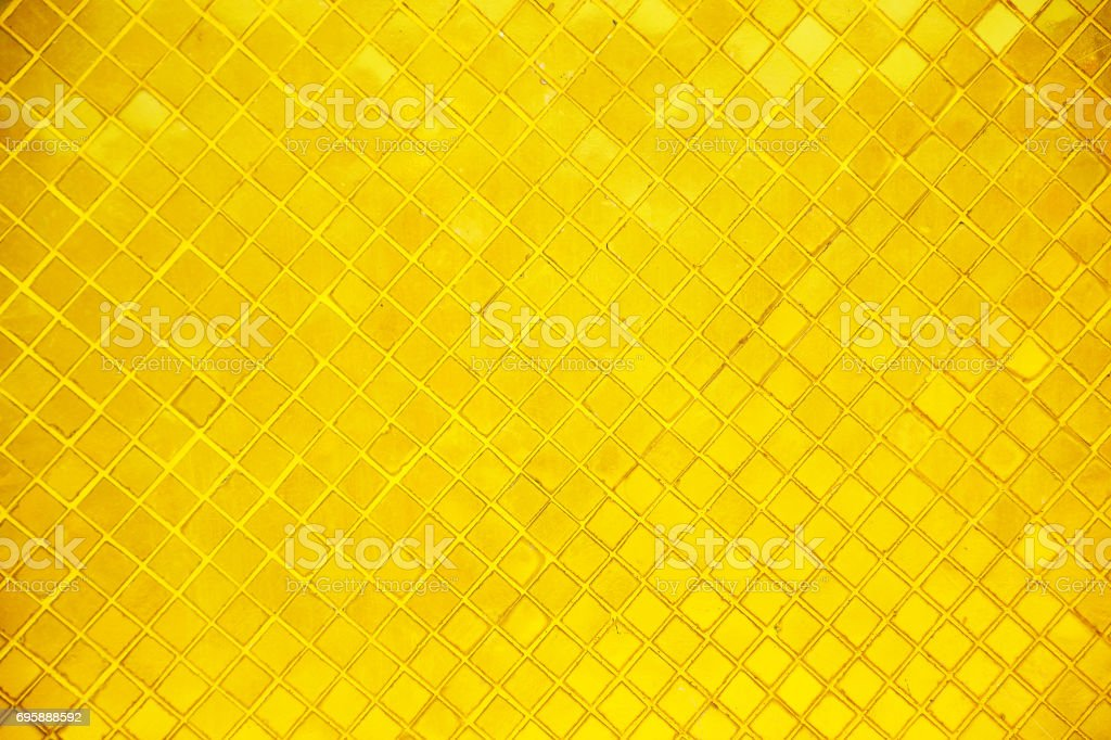 Golden wall the buddhist temple background stock photo