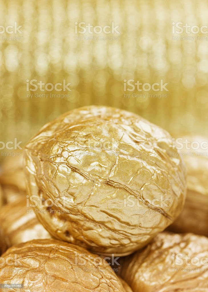 golden walnuts, finance or money concept stock photo