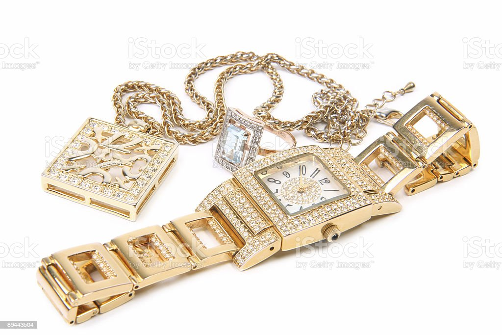 Golden watch ring and necklace stock photo