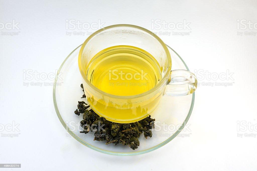 Golden water of Oolong tea. stock photo