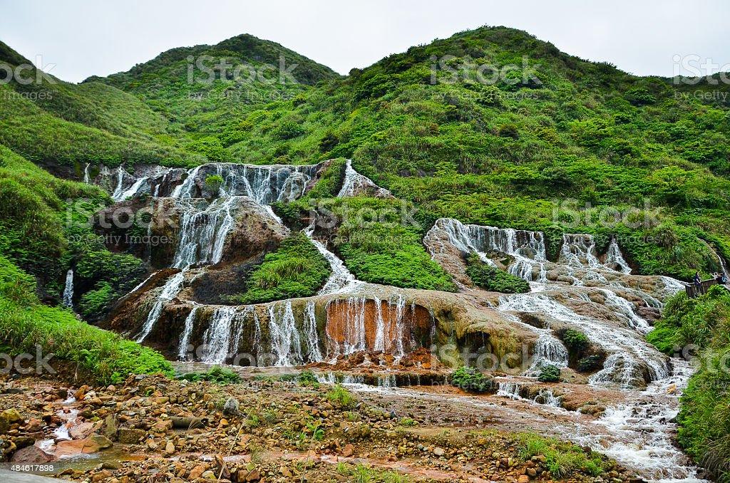Golden waterfall stock photo