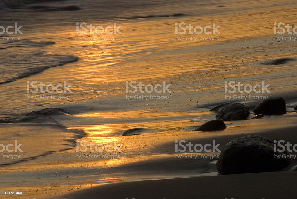 Golden waves roll in. stock photo