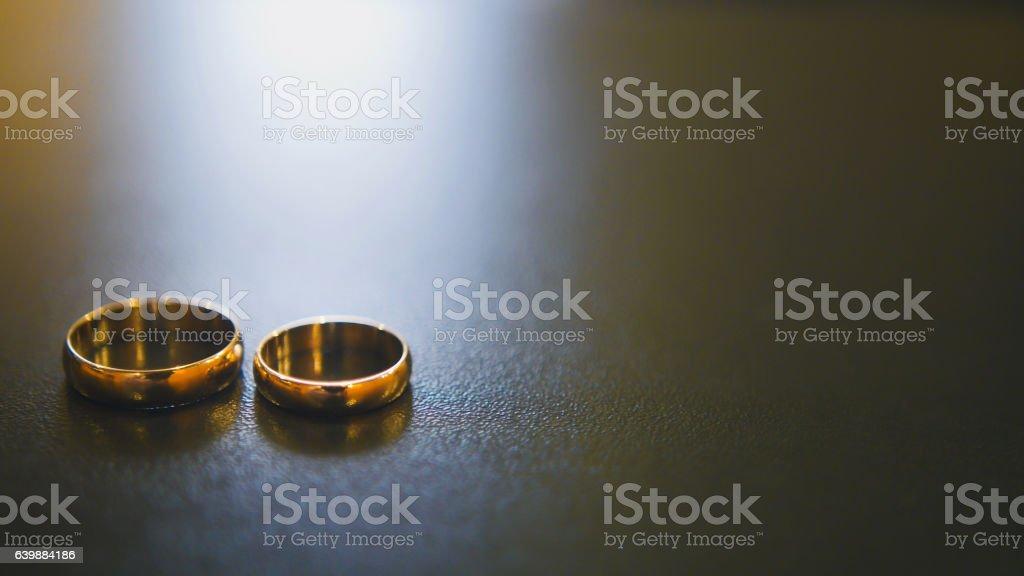Golden wedding rings on table stock photo