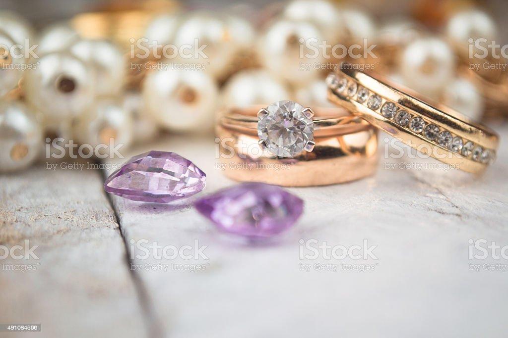 Golden wedding rings on white wood background stock photo