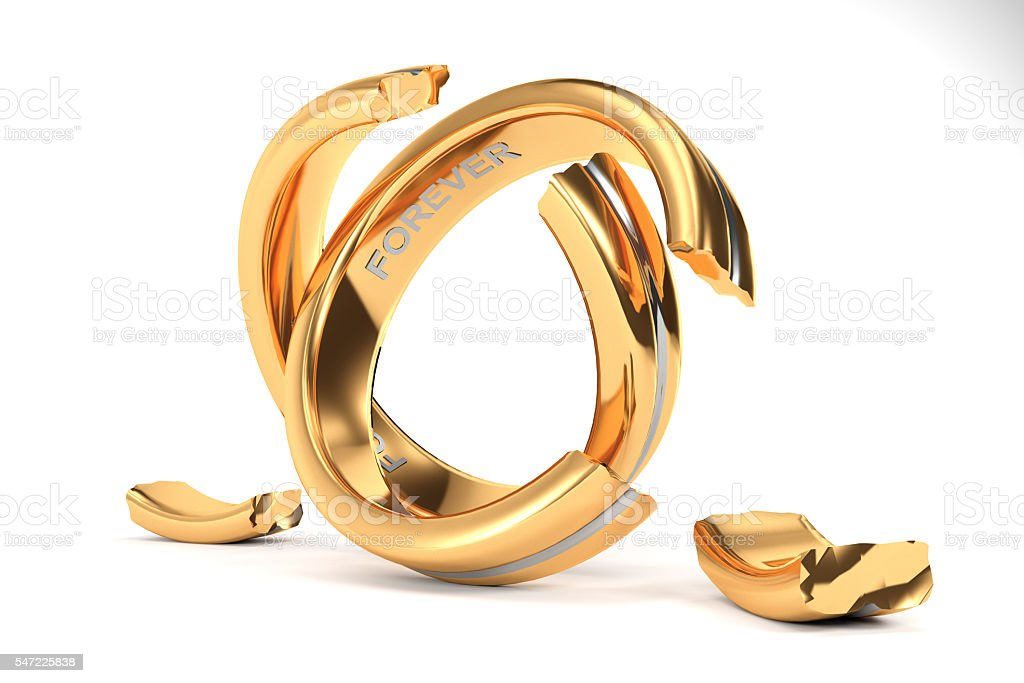 golden Wedding Rings symbolizing the divorce between two people stock photo