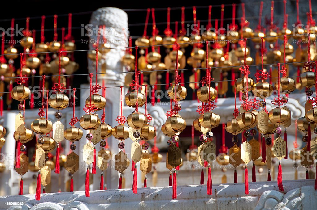 Golden wishing lucky bells in Taiwan temple stock photo