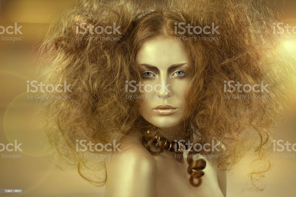 golden woman with backcombing stock photo