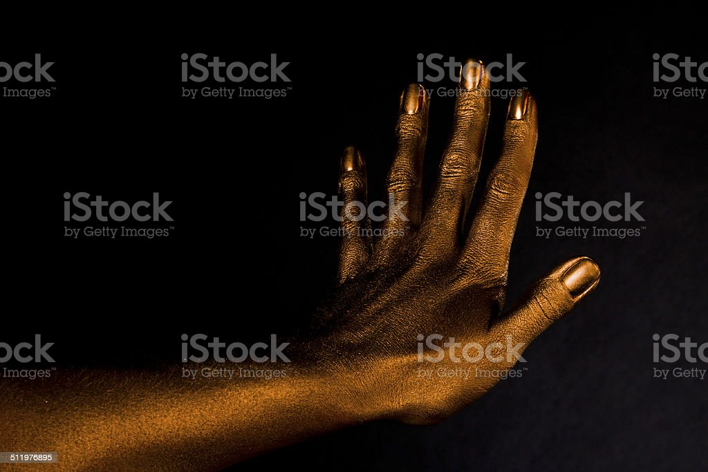Golden woman's hand, horizontal five stock photo