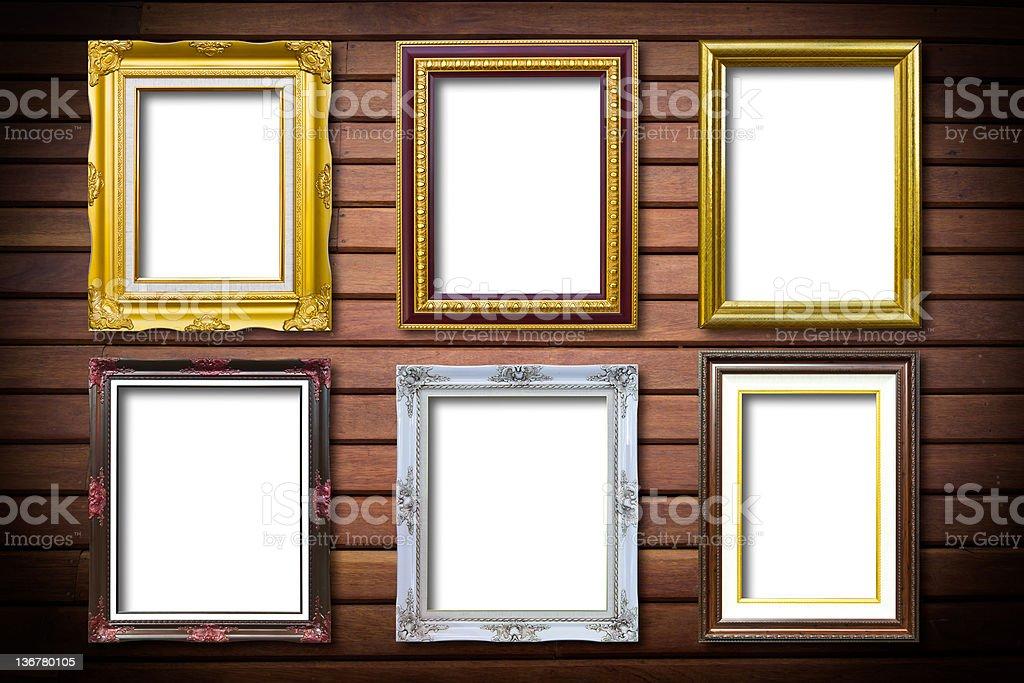 Dorato telaio di legno su sfondo in legno foto stock royalty-free