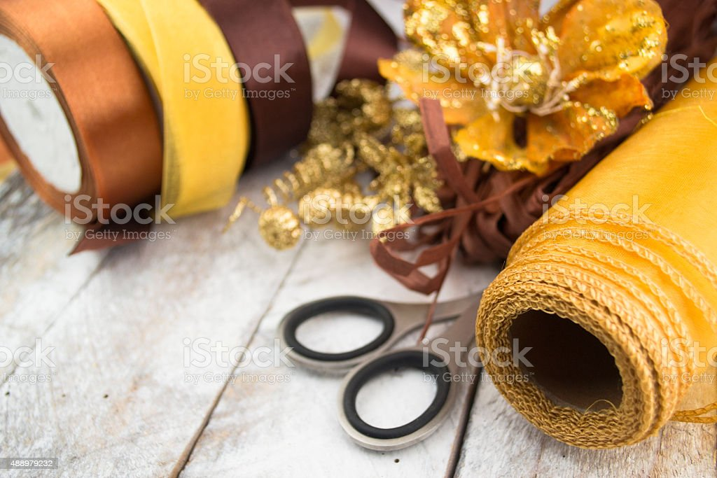 Golden wrapping paper and bow for Christmas present decoration stock photo
