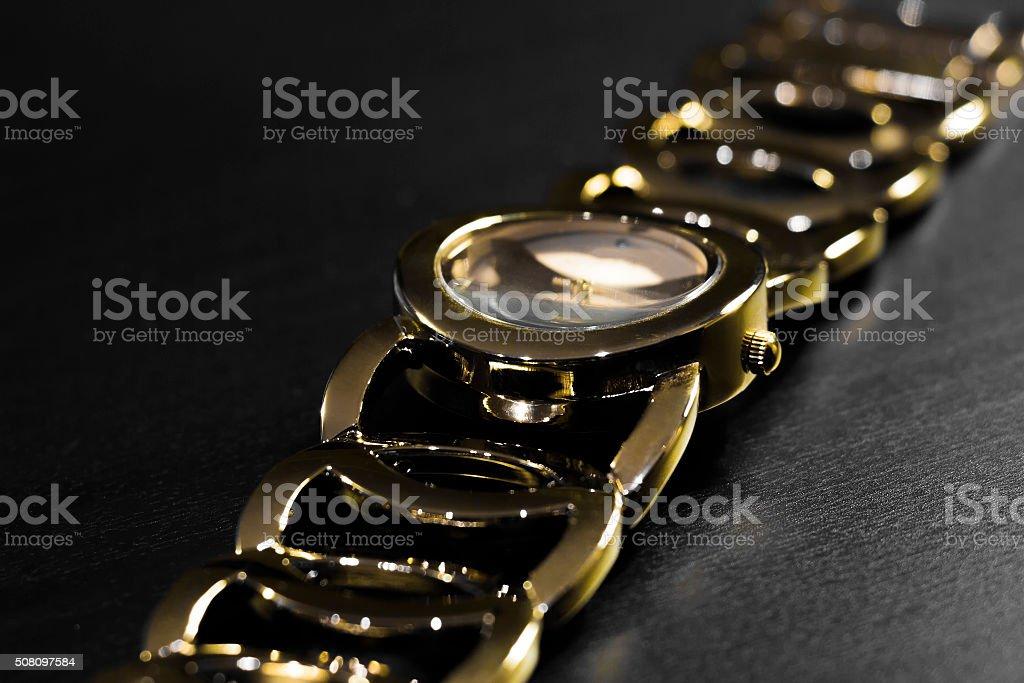 Golden wristwatch with bracelet stock photo