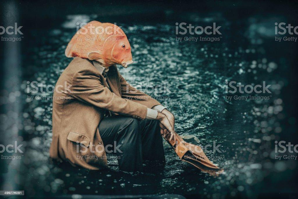 Goldfish Businessman stock photo
