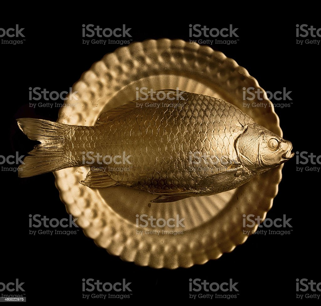 goldfish on golden plate stock photo