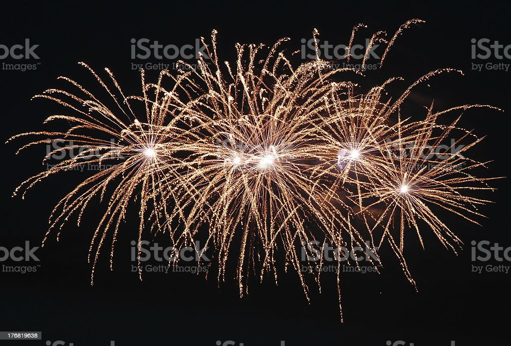Goldish Fireworks Against Black Sky royalty-free stock photo