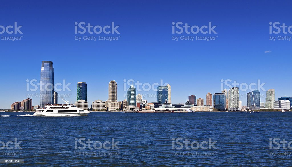 Goldman Sachs Tower and Jersey City skyline. Clear blue sky. stock photo