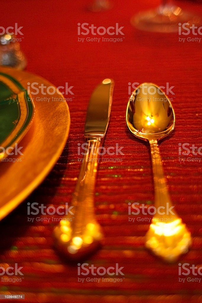 Gold-Plated Knife and Spoon - Holiday Table Setting royalty-free stock photo