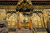 Gold-plated metal door of Temple in Nepal
