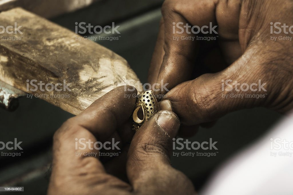 Goldsmith and earring royalty-free stock photo