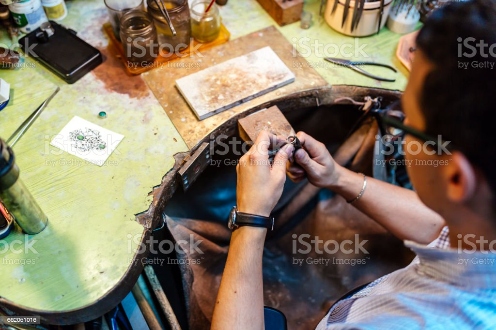 Goldsmith working and creating jewelry stock photo