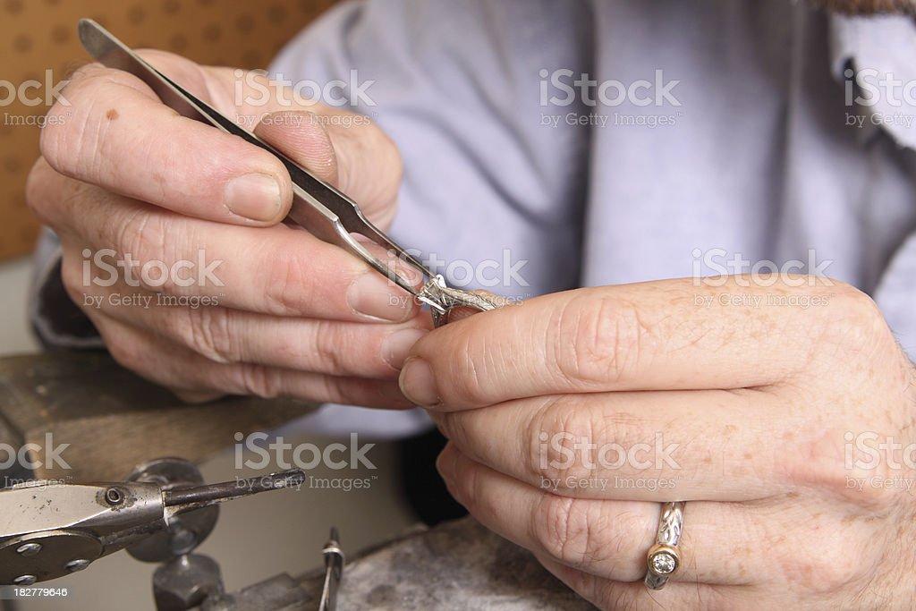 Goldsmith Working on Platinum Ring stock photo