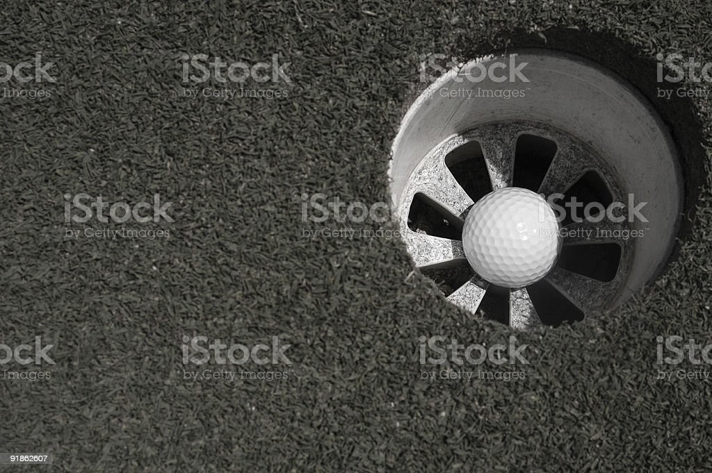 Golf 14 - In the cup B&W stock photo