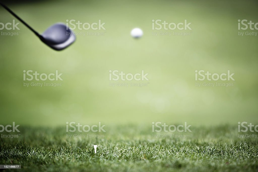 Golf background with driver and ball in air. stock photo