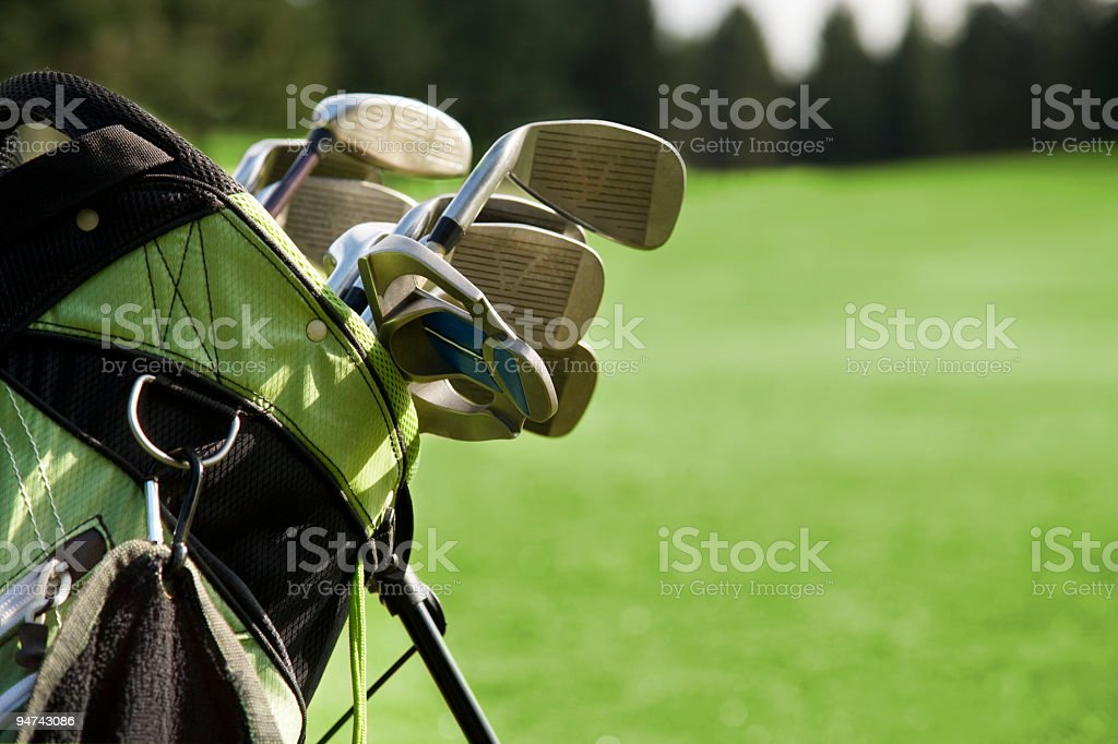Golf Bag and Clubs Against Grass stock photo