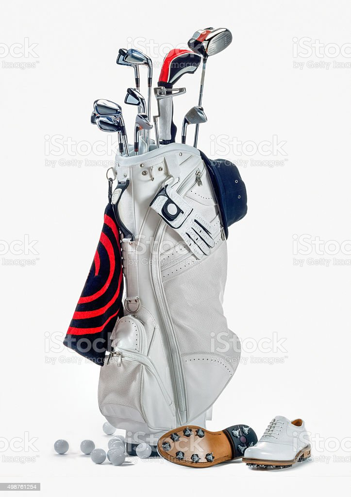 golf bag with clubs and shoes stock photo
