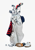 golf bag with clubs and shoes