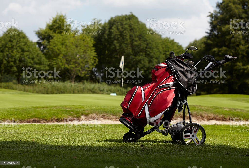 Golf bag with several clubs on a trolley stock photo