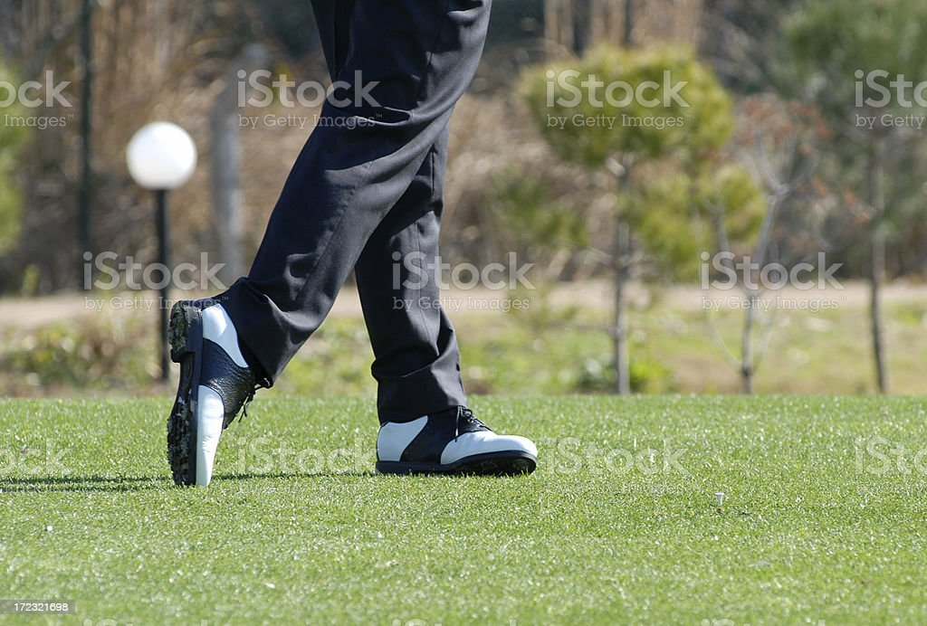 Golf ball after the swing. stock photo