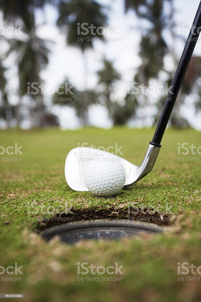 Golf ball and club on the field. royalty-free stock photo