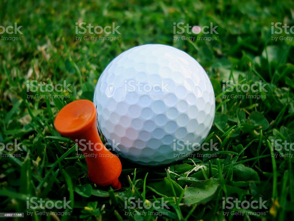 Golf Ball and Orange Tee stock photo