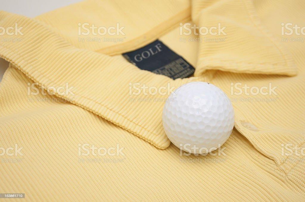 Golf Ball and Polo Shirt stock photo