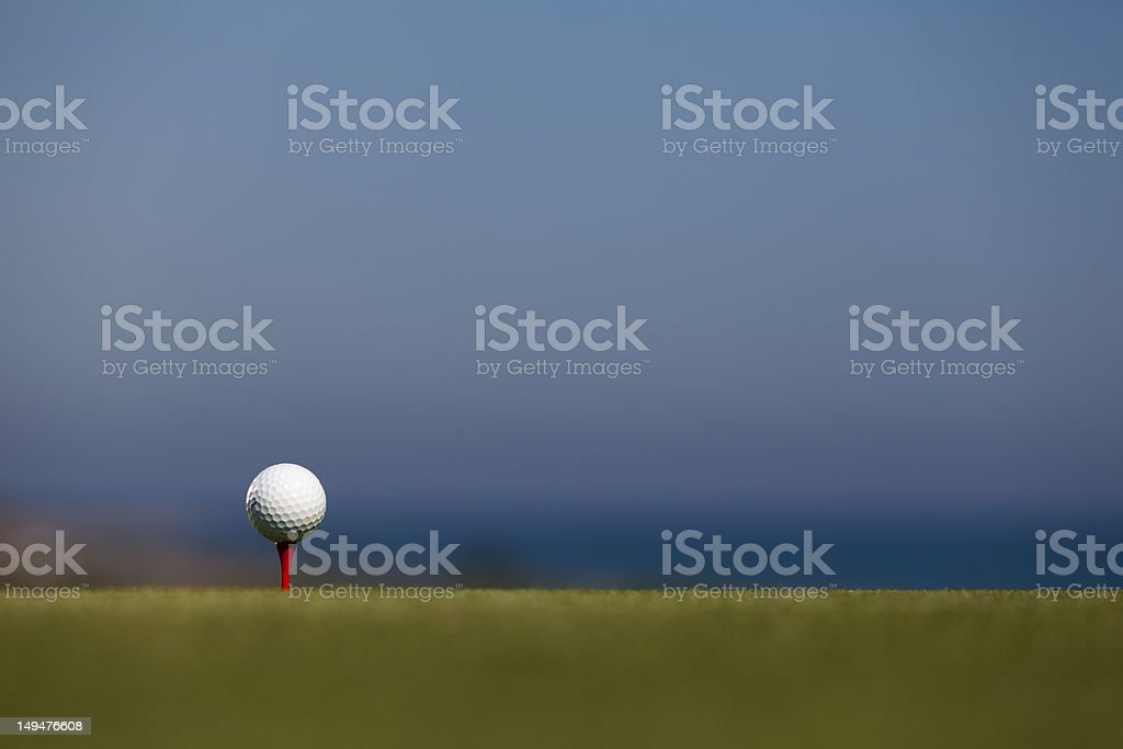 golf ball and red tee royalty-free stock photo