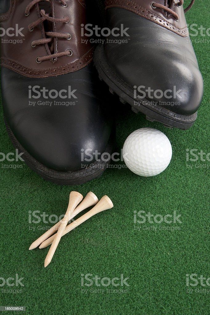 Golf ball and shoes royalty-free stock photo