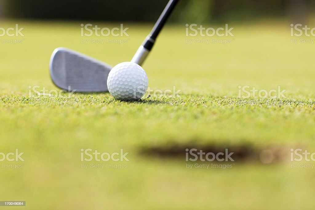 Golf ball and stick on the field. stock photo