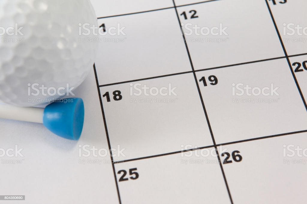 Golf ball and tee golf on calendar stock photo