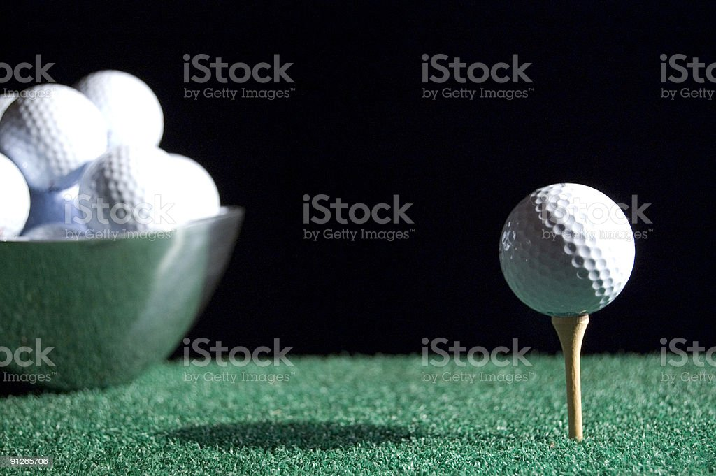 Golf Ball and Tee with bowl royalty-free stock photo