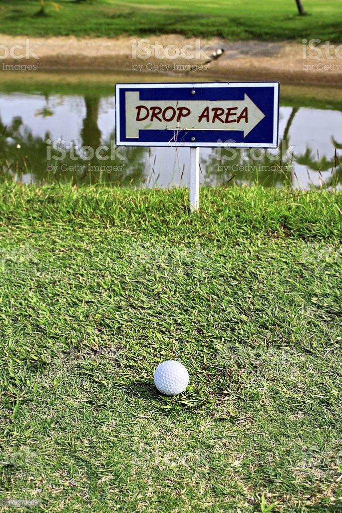 Golf ball at drop area royalty-free stock photo