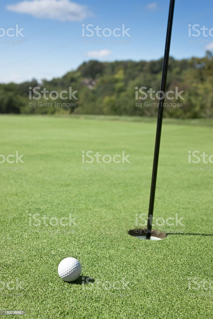 Golf Ball by Hole royalty-free stock photo