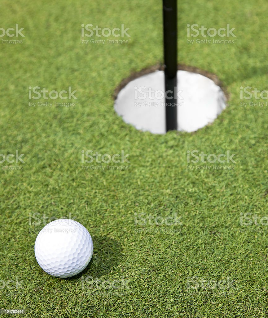 Golf Ball Close to the Pin royalty-free stock photo
