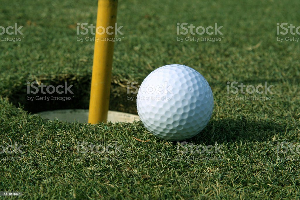 Golf Ball going in royalty-free stock photo