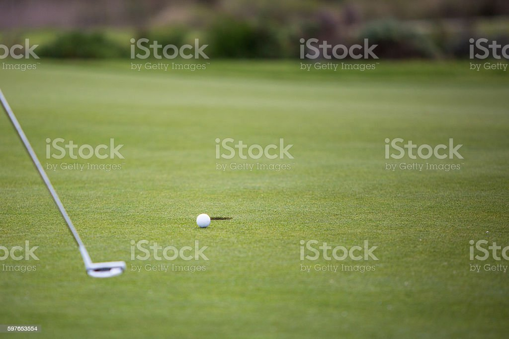 Golf ball heading for the hole! stock photo