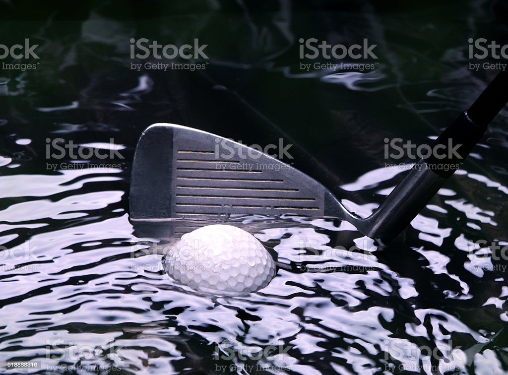 Golf ball in a stream stock photo