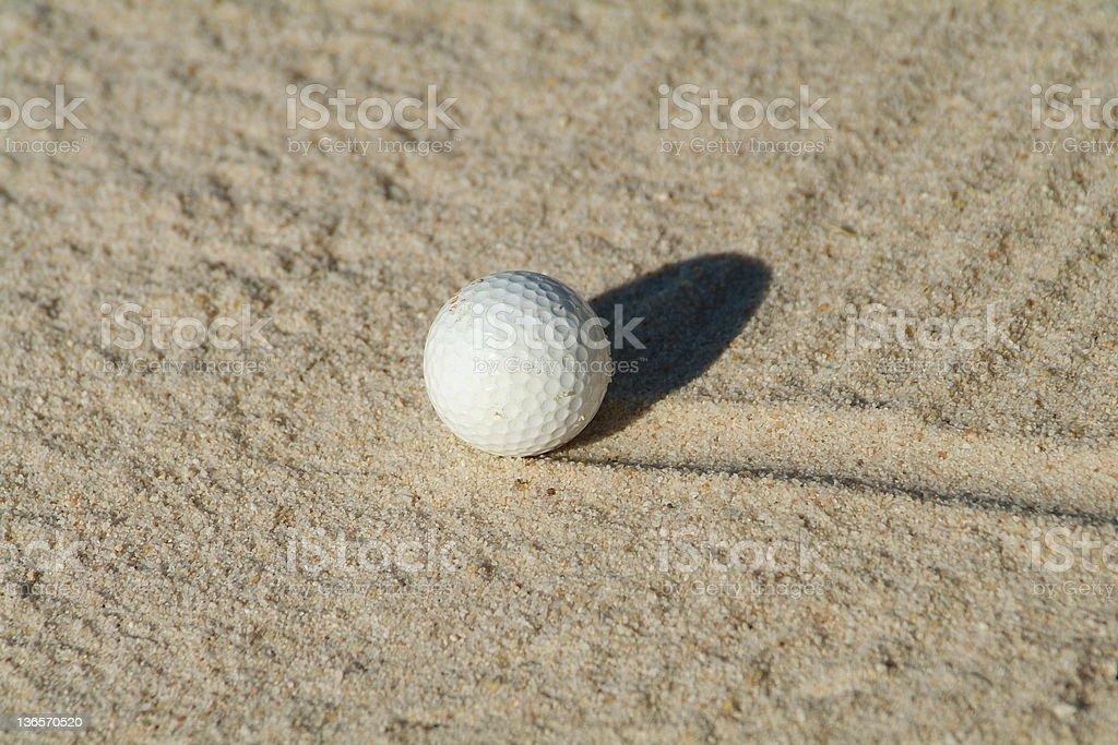 Golf ball in bunker stock photo